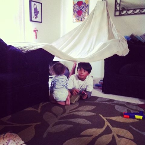 Impromptu Playhouse With an Old Sheet